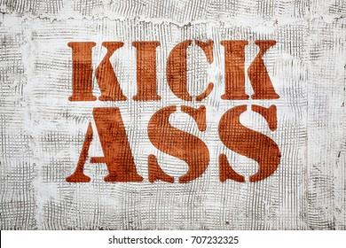 kick ass - red  graffiti sign on a stucco wall