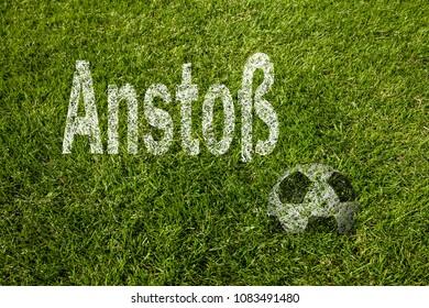 Kick off (in german) written on soccer meadow