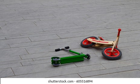Kick Scooters lying on the kids playground