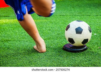 Kick the soccer ball with feet