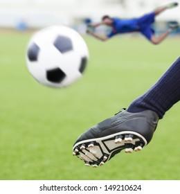 kick soccer ball in goal with loss goalman