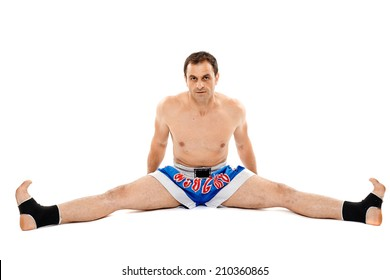 Kickbox or muay thai fighter isolated on white, stretching before training