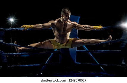 kickboxer stretch out on ring, cross split concept
