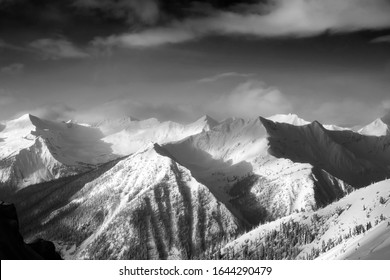 Kicking Horse, Golden, British Columbia, Canada. Beautiful Aerial View of Canadian Mountain Landscape during a vibrant sunny and cloudy morning sunrise in winter. Black and White