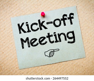 Kick-off meeting Message. Recycled paper note pinned on cork board. Concept Image
