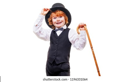 kid actor in the theatre , stylish boy in hat isolated on white background, happy child actor with a cane in his hand dressed in a black suit, talented red curly boy playing in the theatre