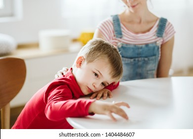 Kid with ADHD don't paying attention to his mother