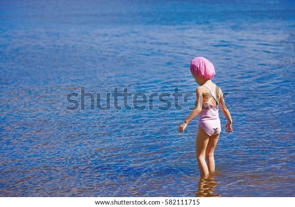 Kid is afraid of cold water in lake