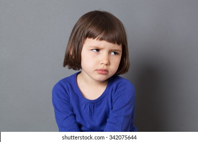 kid attitude concept - grumpy 4-year old child with bob cut sulking with dirty look for complain or disagreement,studio shot