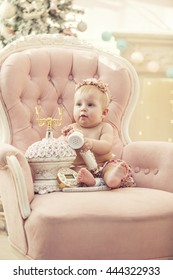 Kid baby girl in pink clothes and happy interior in retro style