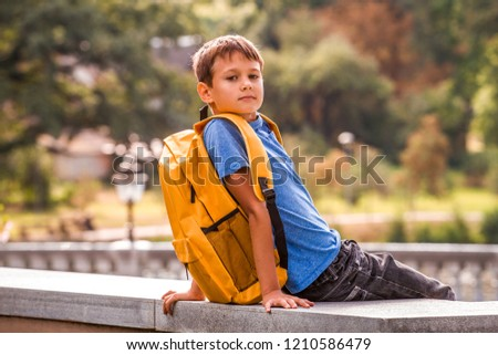 6051911e6e2 Kid Backpack Sitting Outdoors Looking Camera Stock Photo (Edit Now ...