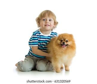 Kid boy with dog spitz, isolated on white background