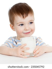 kid boy drinking milk or yogurt from glass isolated