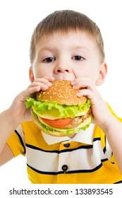 Kid boy eating delicious hamburger