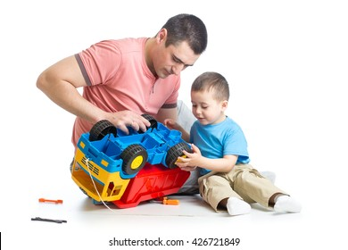 kid boy and his daddy fixing toy trunk
