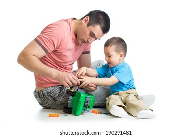 kid boy and his father repair toy car