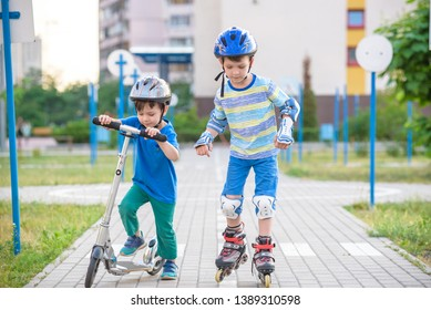 kid boy on roller skates and his sibling brother on scooter wrapped in park. Children wearing protection pads for safe roller skating ride. Active outdoor sport for kids.