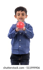 kid boy playing with ball over white background