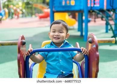Kid boy playing on park