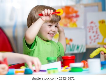 kid boy  playing with play clay at home or  play-school