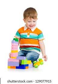 kid boy playing with toys isolated on white background