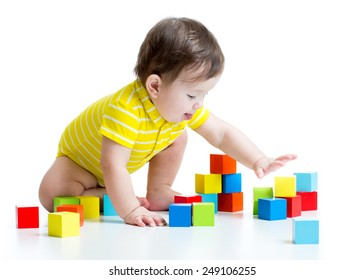 kid boy playing  wooden toy blocks isolated