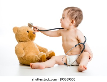 kid boy weared diaper playing doctor with toy