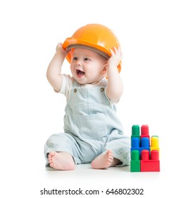kid boy weared hard hat playing with building blocks toy