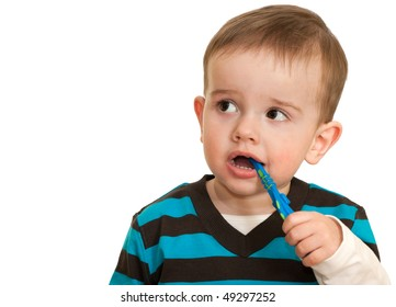 Kid is brushing his teeth; isolated on the white background