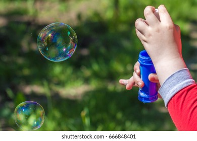 Kid with the bubbles in the sunlight