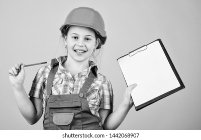 Kid builder girl. Build your future yourself. Initiative child girl hard hat builder worker. Child care development. Safety expert. Foreman inspector. Builder engineer architect. Future profession.