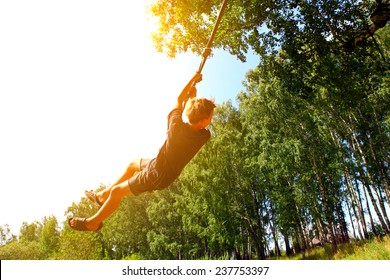 Kid Bungee jumping in the Summer Forest