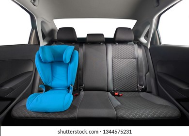 Kid car seat in car. Blue children car seat installed on back seat. Children safety.