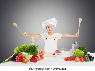 Kid, chef, fruit.