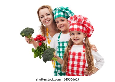 Kid chefs helping their mother preparing healthy food - holding vegetable ingredients, isolated