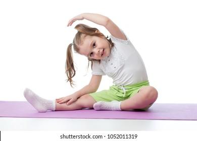 Kid child doing fitness exercises on floor