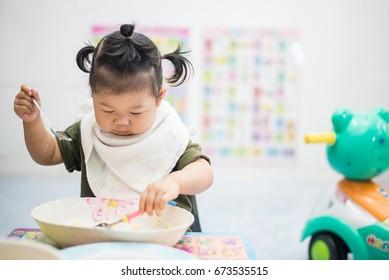 kid child girl eating healthy food at home, Asian girl, Thai girl.