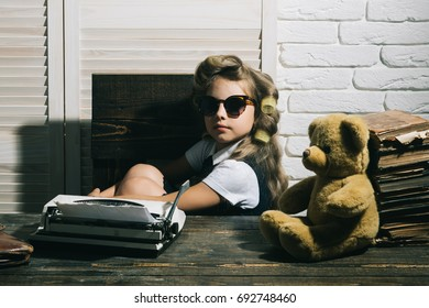 Kid choose career and typing in glasses. Small girl with curler in hair. Education and childhood. Child with briefcase and alarm clock. Little baby secretary with bear and book.