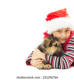 Kid in a Christmas hat and puppy