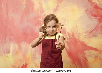 Kid in cook apron. Childhood and education. Cooking with kitchen tool. Small girl on colorful background. Chef child with masher for potato.