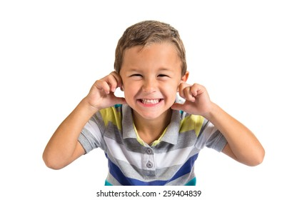 Kid covering his ears over white background
