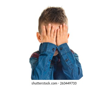 Kid covering his eyes over white background