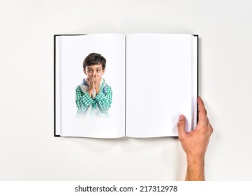 Kid covering his mouth printed on book