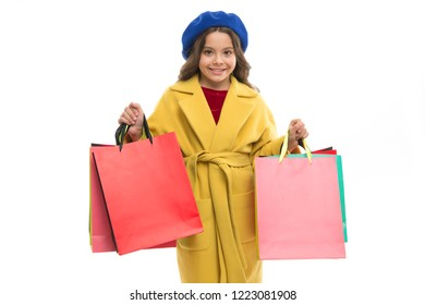 Kid cute little girl hold bunch shopping bags. Child satisfied by shopping isolated white background. Obsessed with shopping and clothing malls. Shopaholic concept. Signs you are addicted to shopping.