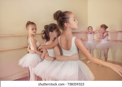 Kid in dance class. Child girl is studying ballet