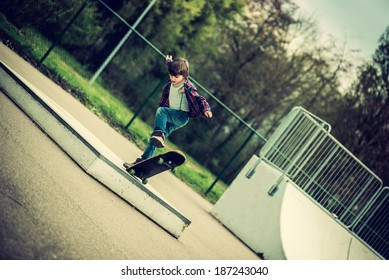 kid doing tricks on his skateboard, vintage effect added