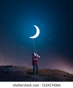 kid drag the moon towards him with a rope in the middle of the night. The concept of accomplish his dreams.