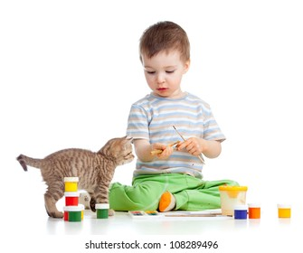 kid drawing paints, cat watching at boy