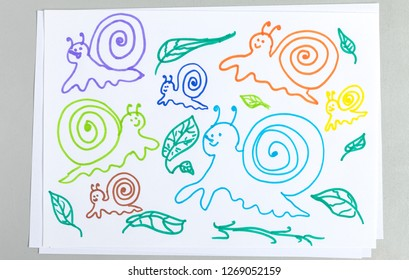 Kid drawings set of different snails and plant leaves isolated on white background - colorful outline child scribble of cute slimy animals with spiral shell and greenery collection.