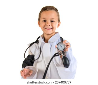 Kid dressed like doctor holding blood pressure monitor